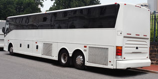 Tour Charter Bus. Read and side views of parked white tour charter bus Stock Photo