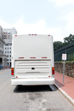 Tour Charter Bus. Rear view of parked white tour charter bus Stock Images