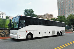Tour Charter Bus. Side and front view of parked tour charter bus Royalty Free Stock Photography