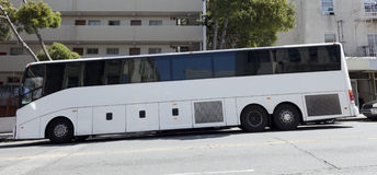 Tour Charter Bus. Side view of parked tour charter bus on San Francisco city street Stock Photos