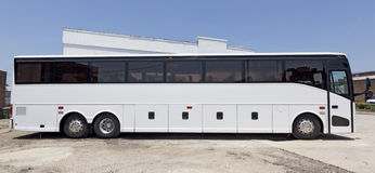 Tour Charter Bus. Side view of parked white tour charter bus Royalty Free Stock Images