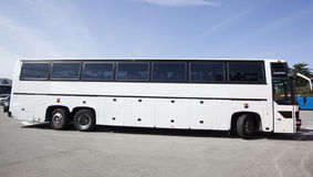 Tour Charter Bus. Side view of parked white tour charter bus Stock Photo