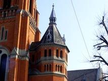 Tour d'église construite avec la brique Photographie stock libre de droits