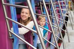 Tour d'ados sur le carrousel Photographie stock libre de droits