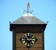 Tour d'horloge avec la palette de vent Photos libres de droits