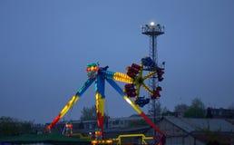 Tour de carrousel de soirée Image stock