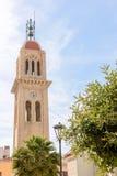 Tour de cloche de tour sur le fond de ciel bleu Photographie stock libre de droits