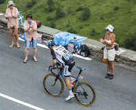 Tour de France Action. Col de Peyresourde,France- July 23, 2014: Fan photographing and cheering the Dutch cyclist Tom Dumoulin (Team  Giant-Shimano) climbing the Royalty Free Stock Image