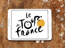 Tour de France bicycle race logo. Logo of Tour de France on samsung tablet. Tour de France is an annual male multiple stage bicycle race primarily held in France Stock Photos