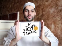 Tour de France bicycle race logo. Logo of Tour de France on samsung tablet holded by arab muslim man. Tour de France is an annual male multiple stage bicycle Royalty Free Stock Image