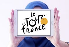 Tour de France bicycle race logo. Logo of Tour de France on samsung tablet holded by arab muslim woman. Tour de France is an annual male multiple stage bicycle Royalty Free Stock Images