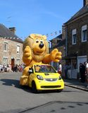 Tour de France caravan throwing gifts into the crowd. Lion Mascot stock photography