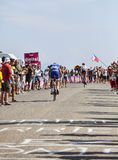 Tour de France. Col de Manse, France- July 16, 2013: Two cyclists pedaling in front of a large audience on a plain road after the ascension to Col de Manse Stock Photo