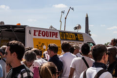 Tour de France Crush. Paris,France,July 22nd 2012: Image of a press car from the advertising caravan in a cowd of people waiting for cyclists during the last Stock Photography