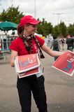 Tour de France - girl give news paper. MULHOUSE - FRANCE - 13 th July 2014 - tour de France - vittel news paper Stock Image
