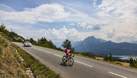 Tour de France Landscape. Chorges, France- July 17, 2013: The French cyclist Guillaume Levarlet from Cofidis Team pedaling during the stage 17 of 100th edition Stock Photography