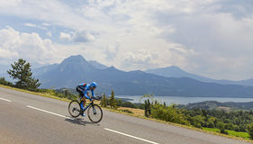 Tour de France Landscape. Chorges, France- July 17, 2013: The Scottish cyclist David Millar from Garmin-Sharp Team pedaling during the stage 17 of 100th edition Royalty Free Stock Photos