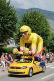 Tour de France publicity caravan. Saint Jean de Maurienne, France - July 24, 2015: The LCL yellow mascot during the passing of the publicity caravan on the road Royalty Free Stock Photos