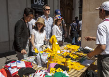 Tour de France Souvenirs. Paris,France,July 22nd 2012: Image of tourists buying from a street stand various specific souvenirs in Paris downtown during the day Stock Image