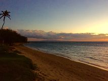 Tour de maître nageur au coucher du soleil Images stock
