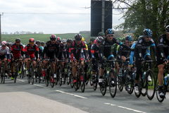 Tour De Yorkshire 2015. Cycle teams taking part in the Tour De Yorkshire bicycle race in April 2015. The cyclists are just approaching Wetwang, near Bridlington Stock Images