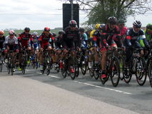 Tour De Yorkshire 2015. Cycle teams taking part in the Tour De Yorkshire bicycle race in April 2015. The cyclists are just approaching Wetwang, near Bridlington Stock Image