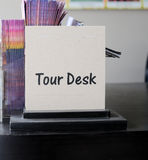 Tour desk sign Stock Photography