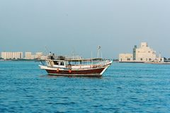 Dhow and museum in qatar Stock Photo