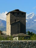 Tour du Bailliage, Aosta ( Italia ). View of Tour du Billiage (Torre dei Balivi) or Tour del Podesta with Le Grand Combin, Aosta (Italy Royalty Free Stock Images