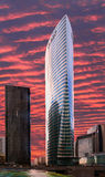 Tour EDF of Paris La Defense on red sky background Royalty Free Stock Images