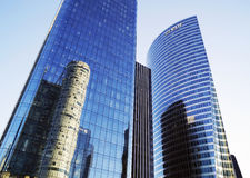 Tour EDF and Tour OPUS 12 in Paris. PARIS, FRANCE - SEPTEMBER 29, 2015: EDF and OPUS 12 skyscrapers in La Defense business district in Paris, France royalty free stock photos