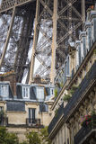 Tour Eiffel behind residential building. The lower part of the Eiffel tower rising behind some typical Parisian residential houses Royalty Free Stock Images
