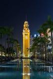 Tour et piscine d'horloge en Hong Kong au crépuscule Photos libres de droits