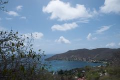 Tour of the Grenadines. Beautiful view of the Grenadines, Port Elizabeth, blue sky and waters Royalty Free Stock Photo