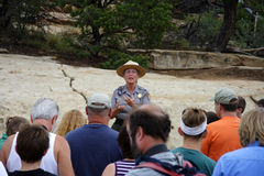 Tour Group. A National Park Service Ranger prepares visitors for a hike to Cliff Palace, Mesa Verde National Park Royalty Free Stock Photo