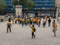 Tour group in gold jackets gather outside British Museum,, Londo Royalty Free Stock Photography