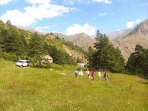 Tour group. Tourists walk on the nature. The North Caucasus Stock Photography