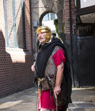 Tour Guide as Roman Soldier in Chester the county city of Cheshire in England. A unique Tourist service in Chester are these Roman Soldiers who bring alive the royalty free stock photo