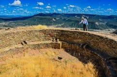 Tour Guide - Chimney Rock National Monument - Colorado. Tour guide explains history of Pueblo people at kiva in Chimney Rock National Monument royalty free stock images