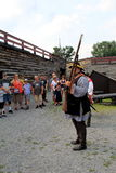 Tour guide demonstrating how to shoot a musket, Fort William Henry,New York,2015 Stock Image