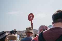 Free Tour Guide Holding Group Number Up On The Island Of Delos, Greece Royalty Free Stock Photography - 160861977