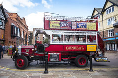 Tour Guide Omnibus in Chester the county city of Cheshire in England. A unique Tourist service in Chester is this old fashioned bus bringing alive the sights in royalty free stock image