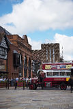 Tour Guide Omnibus in Chester the county city of Cheshire in England. A unique Tourist service in Chester is this old fashioned bus bringing alive the sights in Stock Image