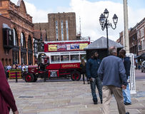 Tour Guide Omnibus in Chester the county city of Cheshire in England. A unique Tourist service in Chester is this old fashioned bus bringing alive the sights in Royalty Free Stock Photography
