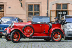 Tour guide Prague. Guide is waiting in his oldtimer for tourist to take them on a tour through the beautiful city of Prague royalty free stock images