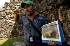 Tour guide talks to tourists at Chiapas in Mexico stock images