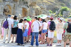 Tour Guide with Tourists on the Ruins Stock Photo