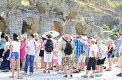 Tour Guide with Tourists on the Ruins Stock Image