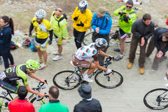 Tour of Italy: Cyclist racing on mountain dirt road Stock Image