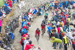 Tour of Italy: Cyclist racing on mountain dirt road Stock Photo